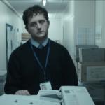 man photocopying looking sad