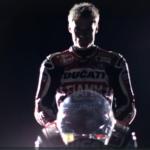 Chris Davies holds motorcycling helmet